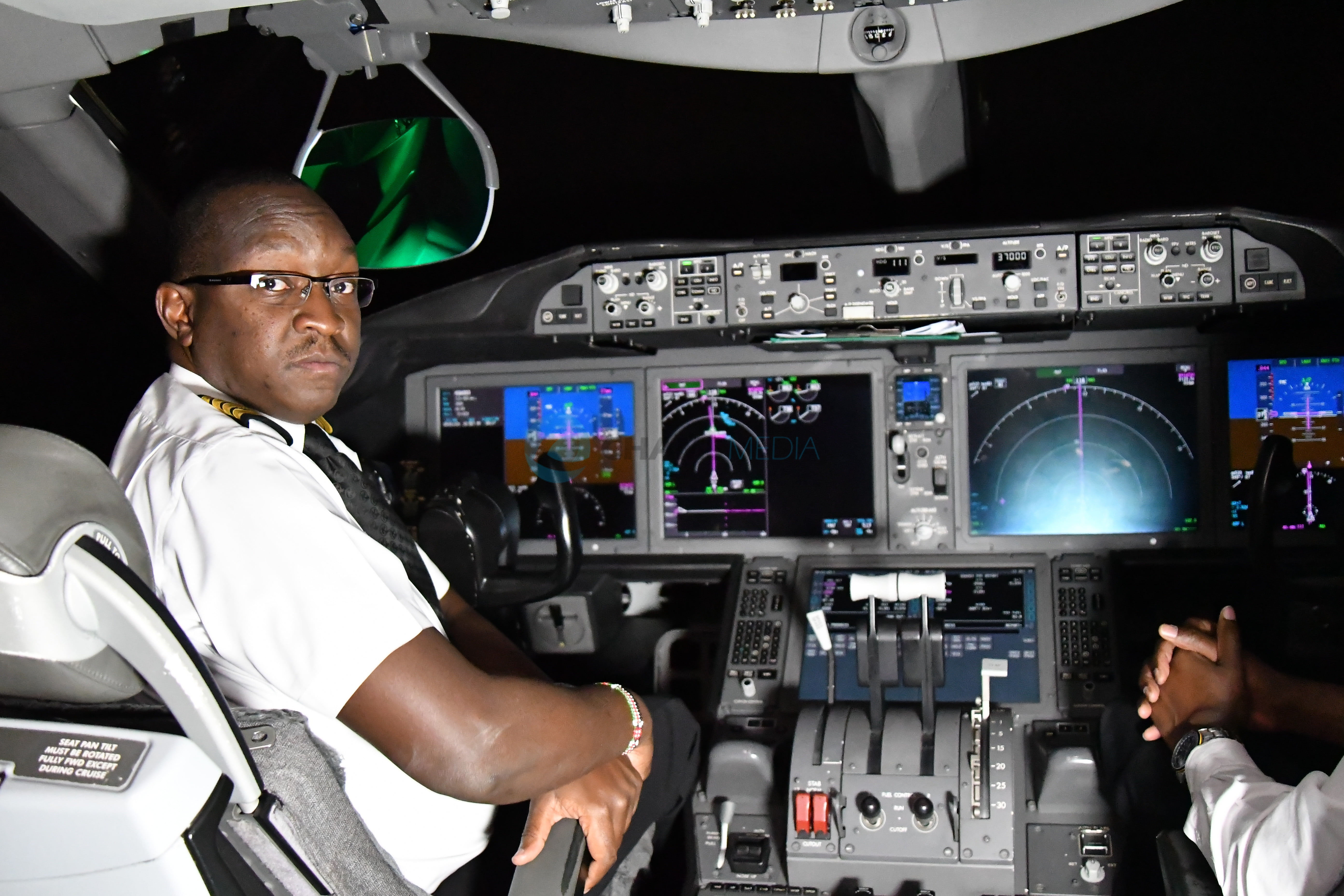KQ Capt George Ayuga in the cockpit on Nairobi-New York Route